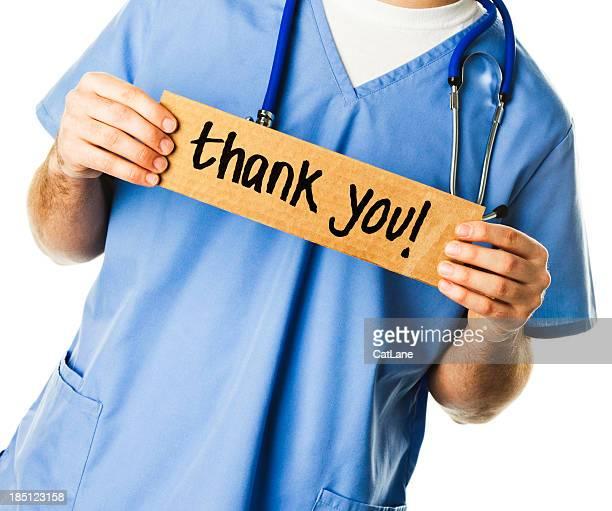 Arzt mit Schild: Vielen Dank!