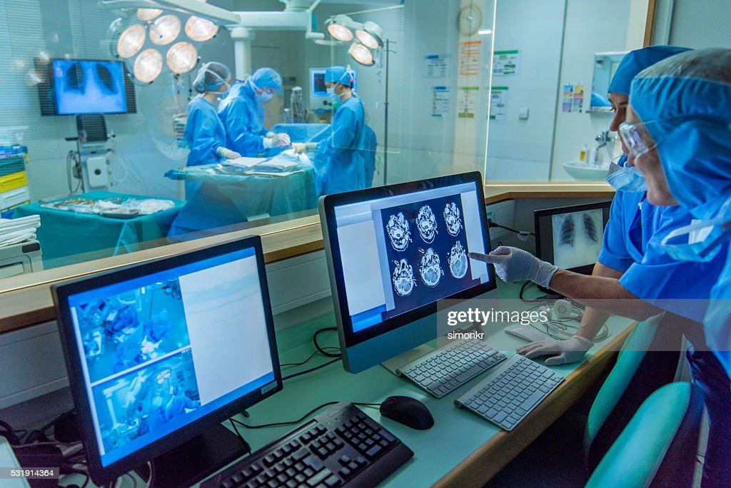 Doctor working in hospital's control room : Stock Photo
