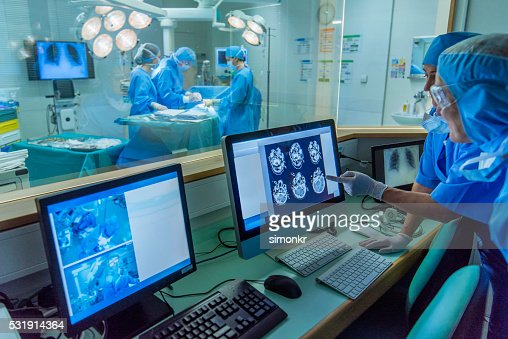 Doctor working in hospital's control room