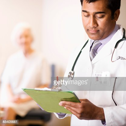 Doctor Writing on Clipboard