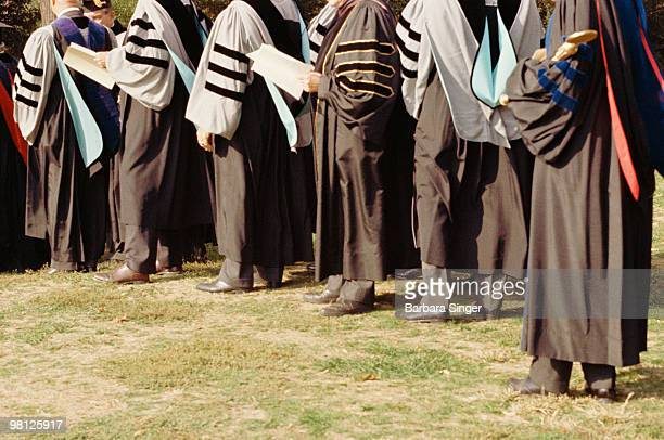 Doctoral students standing in line for graduation ceremony
