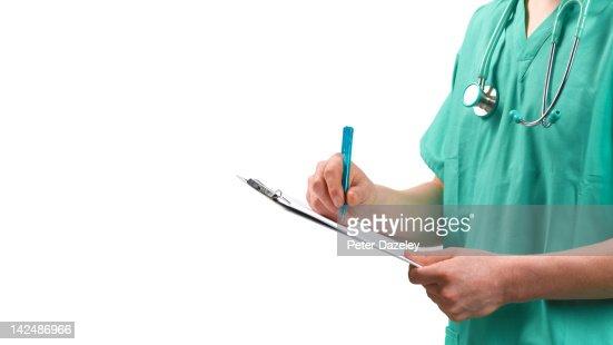 Doctor/nurse with clip board, copy space : Stock Photo