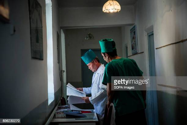 Doctors Abid Madaliev left and Asadzhon Polvonov at a village medical clinic in Beshkent Kyrgyzstan The clinic relies on water gathered from a nearby...