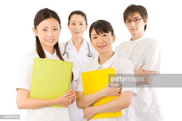 Doctors and female nurses smiling