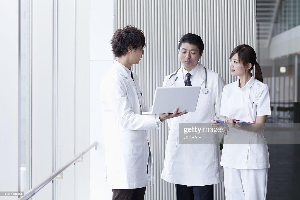 Doctors and nurse talking : Stock Photo