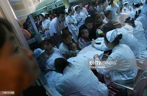 Doctors and nurses examine children suffering from cleft lip and palate at the Xian Jingxi Hospital during a campaign jointly administered by the...