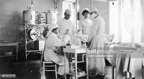 Doctors and nurses in a hospital operating theatre 1916
