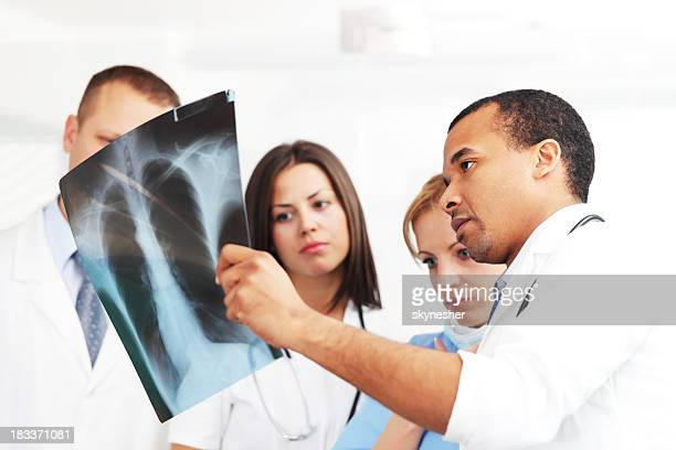 Doctors and nurses looking at x ray.
