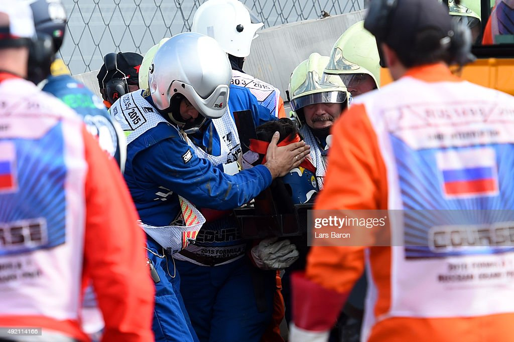 Doctors assist Carlos Sainz of Spain and Scuderia Toro Rosso after he crashed during final practice for the Formula One Grand Prix of Russia at Sochi...