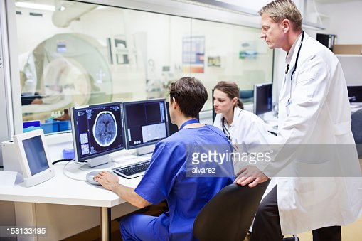Doctors at a computer tomography exam