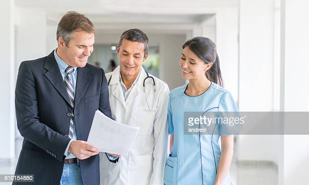 Doctors at the hospital talking about health insurance