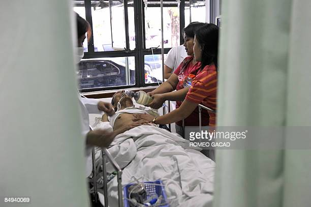 Doctors attend to ailing Filipino World War II veteran Delfin Ramoran at the emergency ward at the Veterans Memorial Medical Center after suffering a...