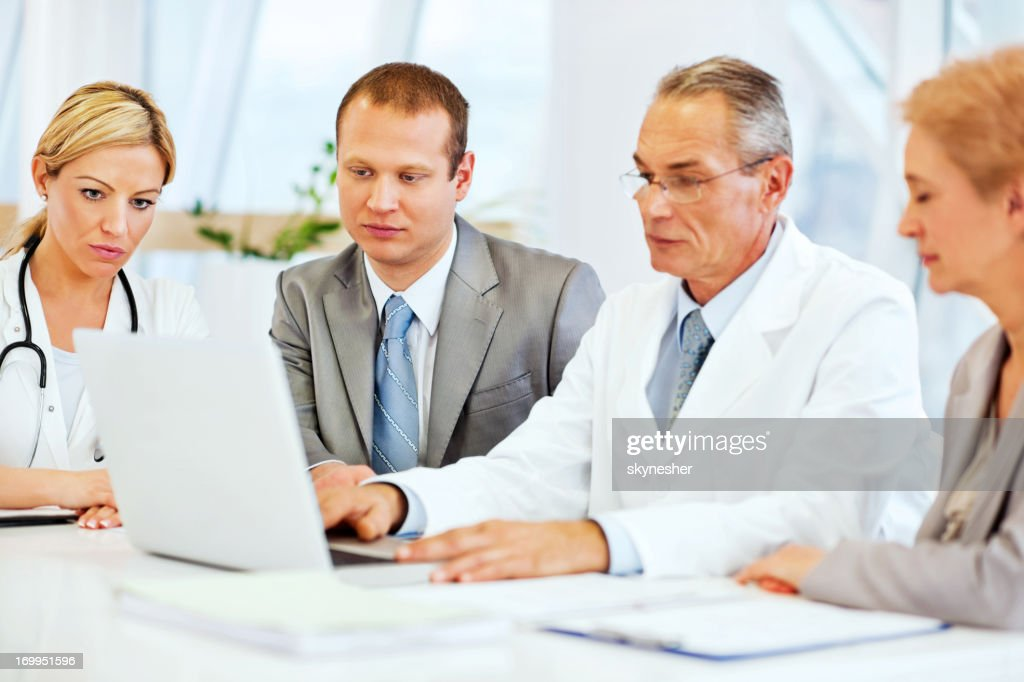 Doctors Collaborating with a Business Team. : Stock Photo