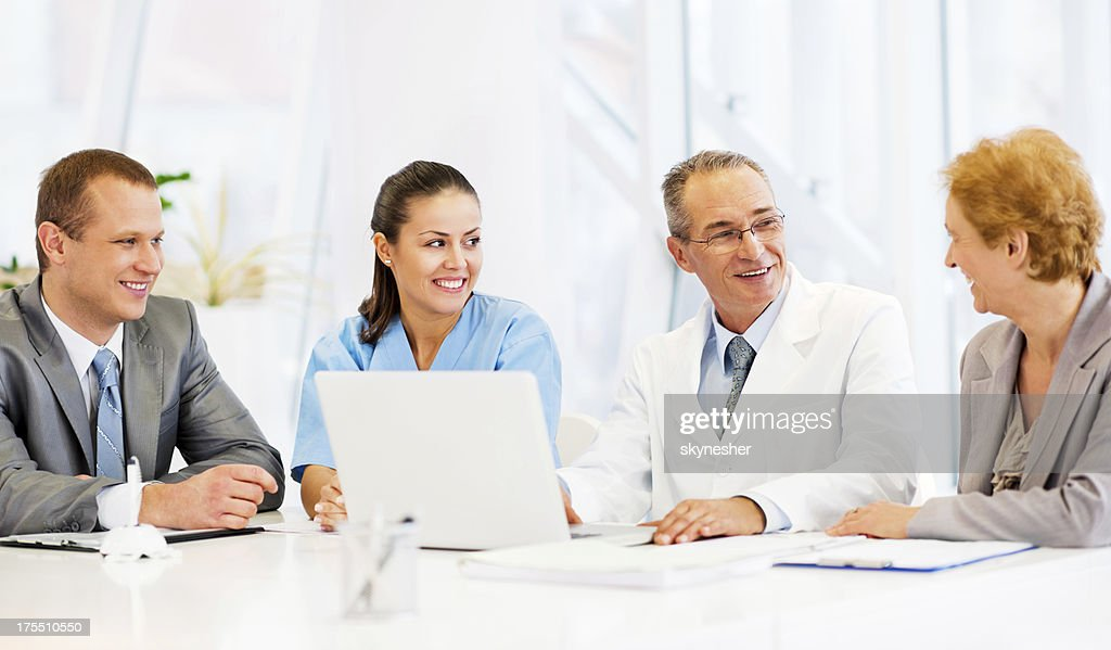 Doctors Collaborating with a Business Team : Stock Photo