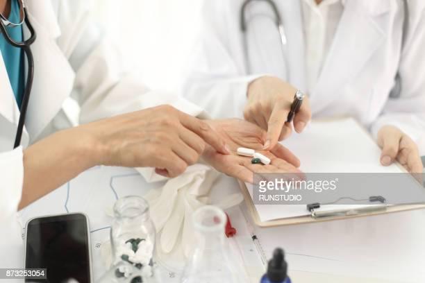 Doctors discussing prescription medicine