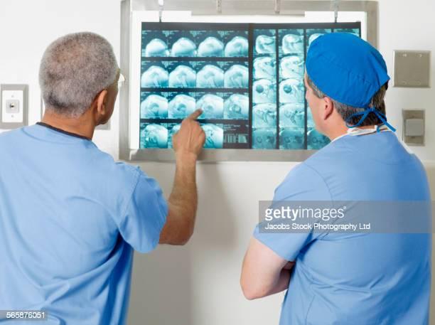 Doctors examining x-rays in hospital