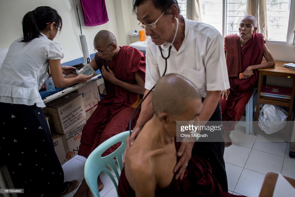 Doctors give medical check-ups to monks at the free Thukha Charity Clinic in Botataung Touwnship, February 11, 2013 in Yangon, Burma. The free health clinic sees some 150 patients a day, with many people forced to sleep in line for several days to get on the examination list, for many across the country these clinics are their only option for basic healthcare as government run clinics are unaffordable.As the country goes through sweeping political and economic reforms, many are hopeful that after decades of neglect the healthcare system will also benefit from the changes. Although health budgets have increased the state health system is still underfunded and struggles to provide basic healthcare as well as essential medicines for treating HIV, Malaria and TB. With sanctions being lifted it is hopeful that again the flow of medical equipment, medicines and the presence of NGO's will increase.