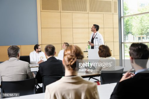 Doctors giving talk in conference room : Stock Photo