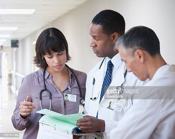 Doctors going over reports