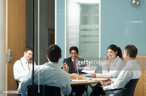 Doctors having a meeting : Stock Photo