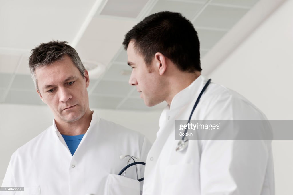 Doctors in conversation : Stock Photo