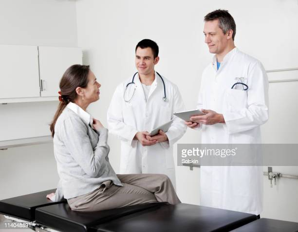 Doctors in conversation with patient