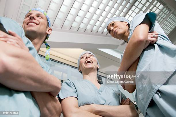 Doctors laughing in hospital corridor