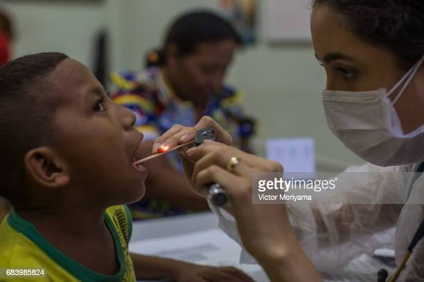 Doctors linked to the Catholic Caritas NGO are doing exams and distributing medicines to Warao Indians on May 16 2017 in Manaus The economic crisis...