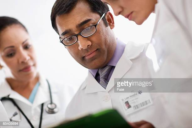 Doctor's Looking at Medical Chart