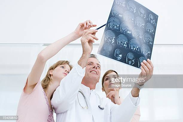 Doctors looking at mire scan
