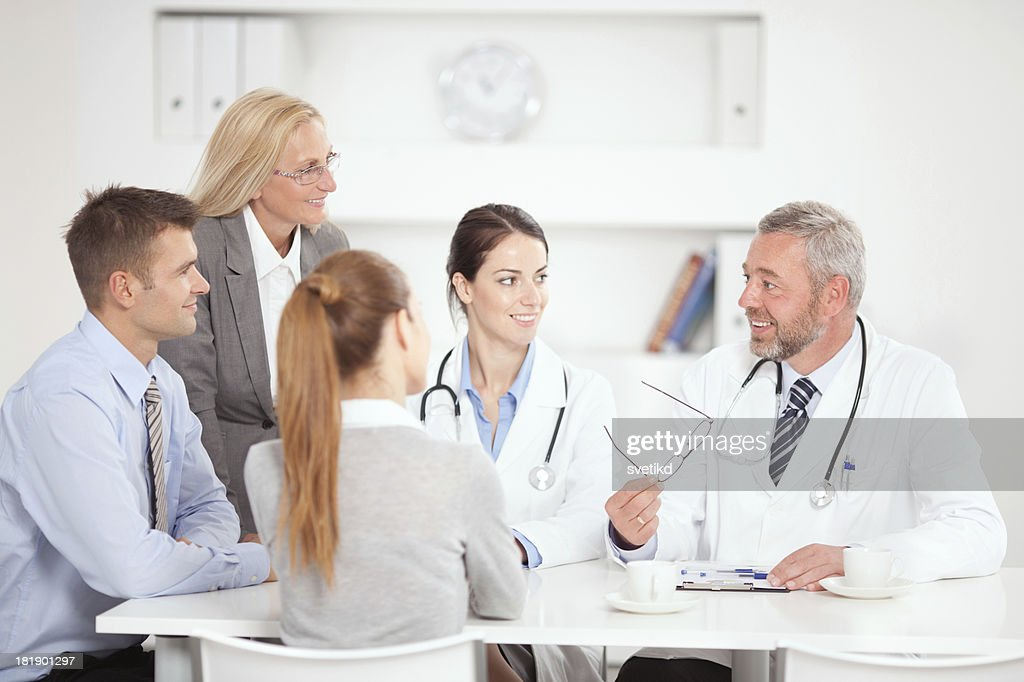 Doctors on business meeting. : Stock Photo