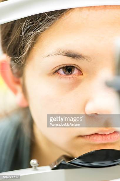 Doctor's Perspective of Teenaged Girl Ready to Have Eye Examined