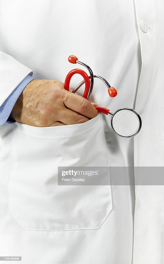 Doctor's pocket with stethoscope : Stock Photo