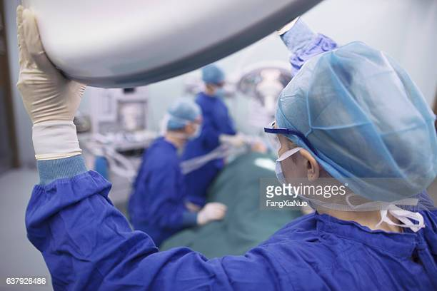Doctors preparing for surgery in hospital operating room