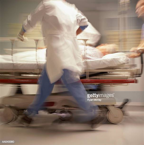 Doctors pushing patient on trolley (blurred motion)