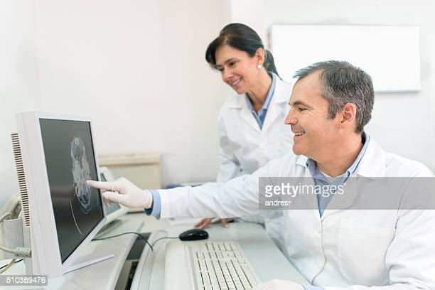 Doctors reading a CT scan