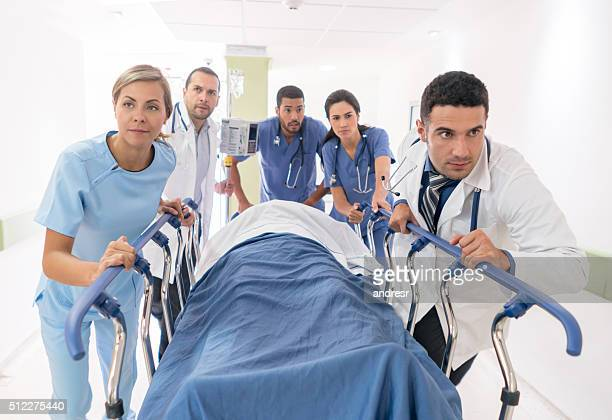 Doctors rushing with patient at the emergency Room