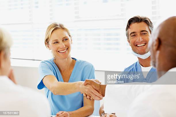 Doctors shaking hands in hospital