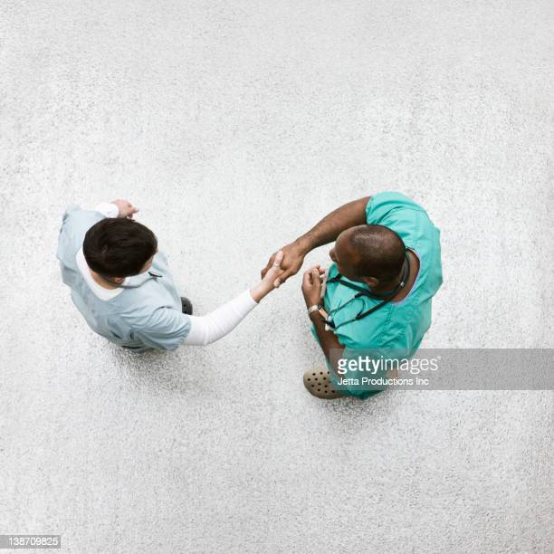 Doctors shaking hands in lobby