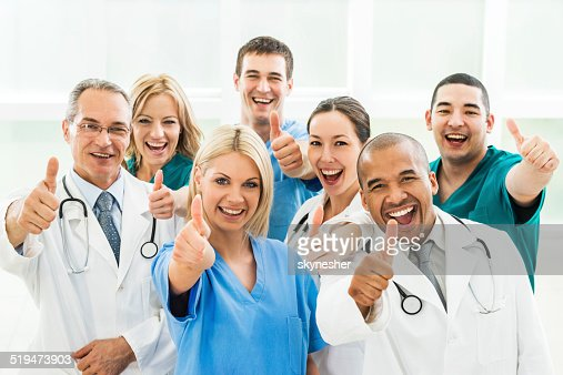 Doctors showing thumbs up.