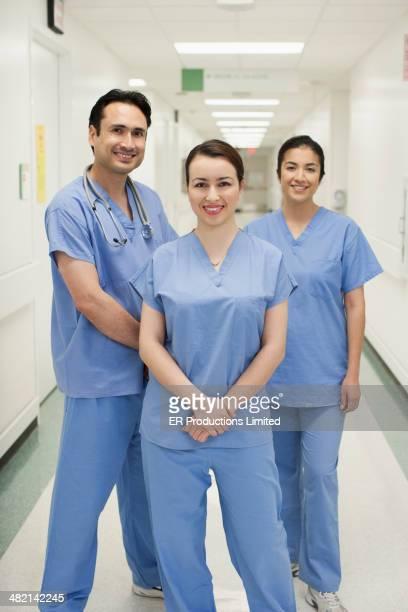 Doctors smiling in hospital corridor