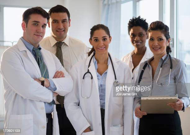 Doctors smiling together in office