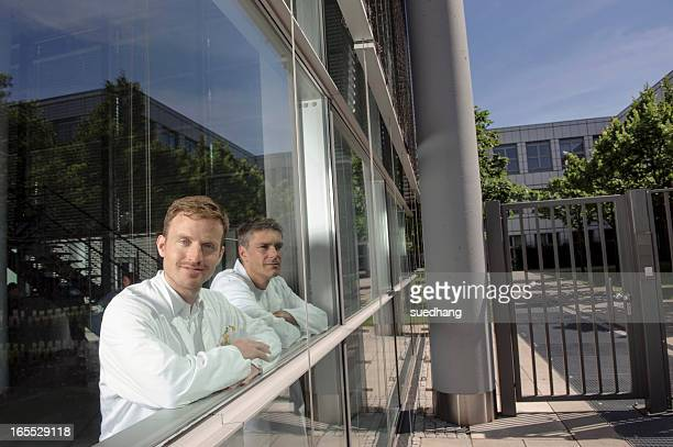 Doctors standing at office window