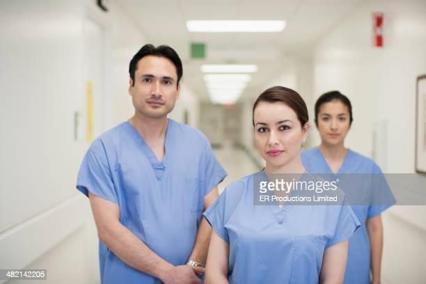 Doctors standing in hospital corridor