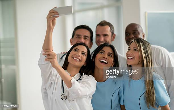 Doctors taking a selfie at the hospital