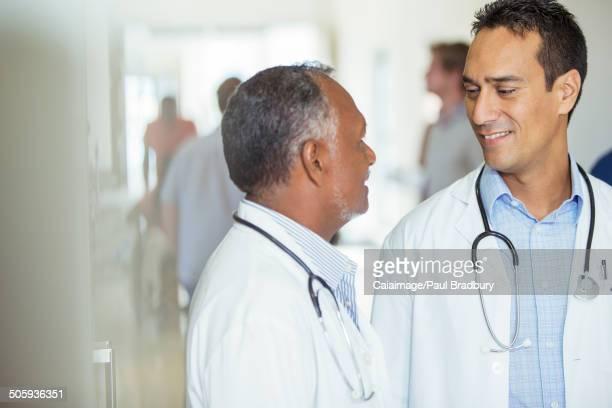 Doctors talking in hospital hallway