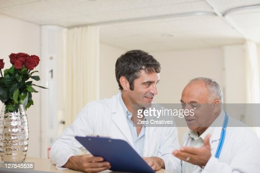 Doctors talking in hospital : Stock Photo