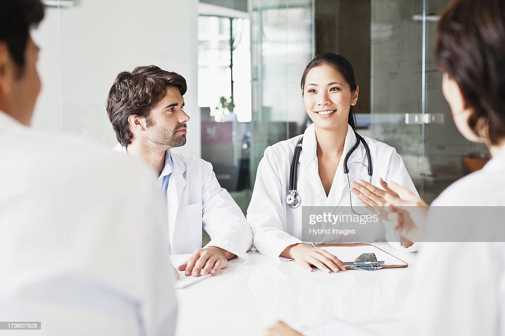Doctors talking in meeting : Stock Photo