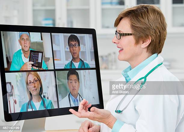 Doctors talking in video conference in hospital