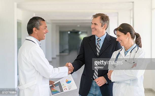 Doctors talking to business man about medical insurance